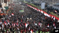 Supporters of Shiite Houthi rebels attend a rally in Sanaa, Yemen, Tuesday, Dec. 5, 2017. The killing of Yemen's ex-President Ali Abdullah Saleh by the country's Shiite rebels on Monday, as their alliance crumbled, has thrown the nearly three-year civil w