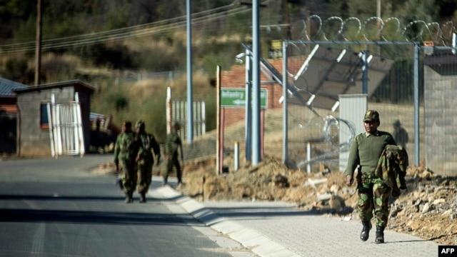 Soldiers walks inside the Makoanyane Barracks in Maseru, Leotho, Sep. 1, 2014.