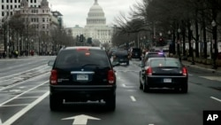 President Obama's motorcade travels down Pennsylvania Avenue toward the Capitol, Washington, D.C., March 12, 2013.