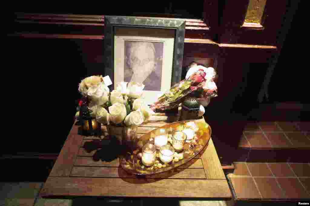 A portrait and flowers in memory of actor Philip Seymour Hoffman is displayed outside Philip Marie Restaurant and bar on Hudson Street in Manhattan, New York, Feb. 2, 2014.