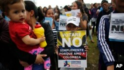 """File -- Opponents to the peace deal signed between the Colombia government and rebels of the Revolutionary Armed Forces of Colombia promote the """"No"""" vote in Oct. 1, 2016, referendum in Bogota, Colombia. Colombians narrowly rejected the deal."""