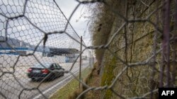 FILE - A border crossing and a fence are seen in in the village of Spielfeld, Austria, at the Austria-Slovenia border, Feb. 21, 2017.