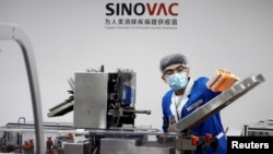 A man works in the packaging facility of Chinese vaccine maker Sinovac Biotech, developing an experimental coronavirus disease (COVID-19) vaccine, in Beijing, China, Sept. 24, 2020.
