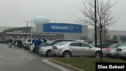 FILE - Shoppers walk in the parking lot of a Walmart store in Fairfax, Virginia. (Photo: Diaa Bekheet) Walmart says it will stop selling amunitions for handguns and assault-style weapons.