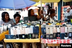 Women vendors display Nokia phone models for sale along with smartphones at the 'Computer Village' in Ikeja district in Nigeria's commercial capital Lagos, Nigeria, May 31, 2017.