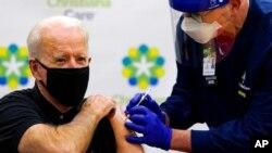 President-elect Joe Biden receives his second dose of the coronavirus vaccine at ChristianaCare Christiana Hospital in Newark, Del., Jan. 11, 2021.