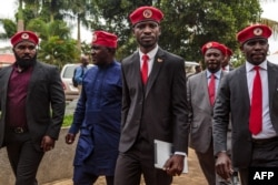 FILE - Singer turned politician Robert Kyagulanyi, also known as Bobi Wine, arrives for a press conference, held at his home in Magere in the outskirts of Kampala, July 24, 2019.