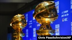 FILE - Replicas of Golden Globe statues are seen at the nominations for the 77th annual Golden Globe Awards in Beverly Hills, Calif., Dec. 9, 2019.