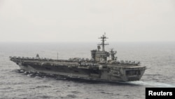 FILE - The aircraft carrier USS Theodore Roosevelt (CVN 71) transits the South China Sea in this U.S. Navy picture taken Oct. 29, 2015. The Philippines has asked the United States to hold joint naval patrols, a defense ministry spokesman said on Thursday, amid a territorial dispute with China in the South China Sea.