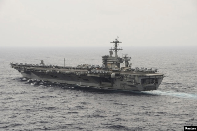 FILE - The aircraft carrier USS Theodore Roosevelt (CVN 71) transits the South China Sea in this U.S. Navy picture taken Oct. 29, 2015.