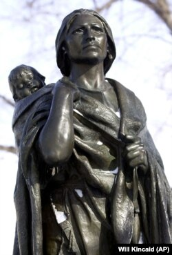 A statue of Sacagawea, an Indian translator for the Lewis and Clark expedition, is shown at the state Capitol in Bismark, North Dakota. (AP Photo/Will Kincaid)