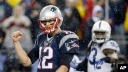 New England quarterback Tom Brady celebrates a touchdown by LeGarrette Blount in the AFC Championship, Jan. 18, 2015.