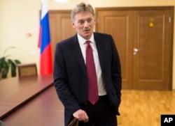 FILE - President Vladimir Putin's spokesman Dmitry Peskov speaks to a reporter in Moscow.