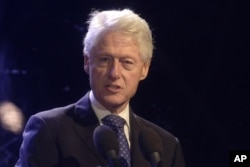 Former President Bill Clinton speaks during a rally in Tel Aviv, Israel, marking 20 years since the assassination of Israeli Prime Minister Yitzhak Rabin, Oct. 31, 2015.