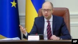 Ministre wa mbere wa Ukraine Arseniy Yatsenyuk mu nama y'abashikiranganji, i Kiev, ku murwa mukuru wa Ukraine.