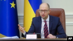 FILE - Ukrainian Prime Minister Arseniy Yatsenyuk speaks during Cabinet in Kyiv, Nov. 25, 2015.