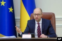FILE - Ukrainian Prime Minister Arseniy Yatsenyuk speaks during Cabinet in Kyiv, Ukraine, Nov. 25, 2015.