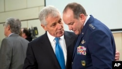U.S. Secretary of Defense Chuck Hagel, left, speaks with Supreme Allied Commander Europe U.S. General Philip Breedlove during a round table meeting of the North Atlantic Council at NATO headquarters in Brussels, Feb. 5, 2015.