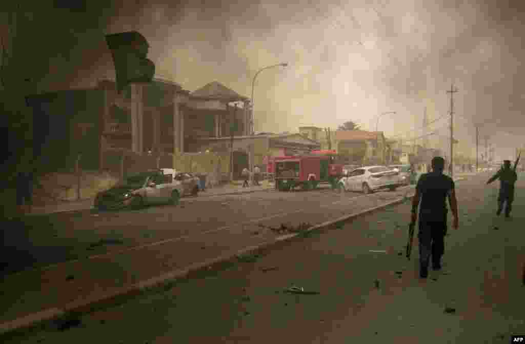 May 19: Iraqi security forces inspect the scene of a bombing in Kirkuk, Iraq. (AP Photo/Emad Matti)