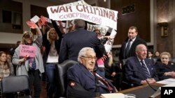 Protesters interrupt a Senate Armed Services hearing on Capitol Hill in Washington, Thursday, January 29, 2015.
