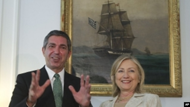 Greek Foreign Minister Stavros Lambrinidis , left, and US Secretary of State Hillary Rodham Clinton speak on Sunday July 17, 2011 during a meeting at the Ministry of Foreign Affairs in Athens