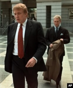 FILE - Billionaire real estate developer Donald Trump, left, walks to the Federal Courthouse in Newark, N.J., with Roger Stone, the director of Trump's presidential exploratory committee, Oct. 25, 1999, for the swearing-in of Trump's sister as a federal appeals court judge.