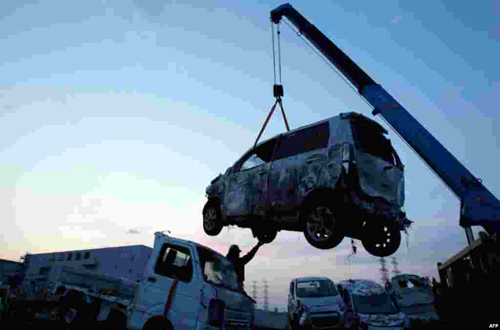 March 29: New Suzuki vehicles, destroyed by tsunami waters from the March 11 massive earthquake, are piled on the Suzuki company lot in Sendai, Japan. (AP Photo/Wally Santana)