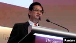 FILE - Vietnam's Prime Minister Nguyen Tan Dung gives the keynote address at the 12th International Institute for Strategic Studies Asia Security Summit, Singapore, May 31, 2013.