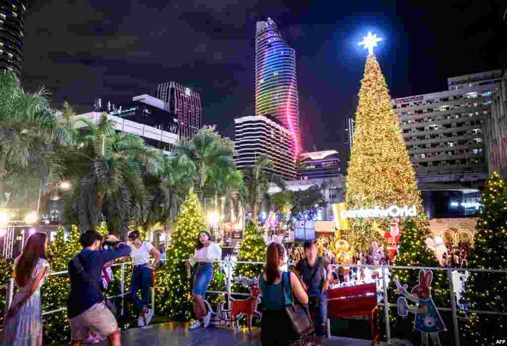 People enjoy the holiday season lights in downtown Bangkok.