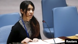 FILE - Nadia Murad Basee, a 21-year-old Iraqi woman of the Yazidi faith, speaks to members of the Security Council during a meeting at the United Nations headquarters in New York.