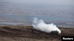 An Israeli tank maneuvers close to the cease-fire line between Israel and Syria on the Israeli-occupied Golan Heights, November 13, 2012.