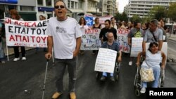 Disabled Greeks march during a rally against new austerity measures, in central Athens, September 12, 2012.