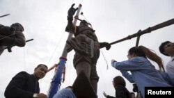 FILE - Thai people pay their respect to giant bronze statues of former King Ram Khamhaeng after a religious ceremony at Ratchapakdi Park in Hua Hin, Prachuap Khiri Khan province, Thailand. The park has been at the center of a corruption scandal.