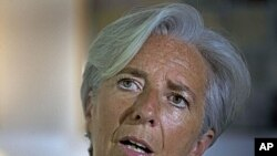 French Finance Minister Christine Lagarde addresses a press conference, in New Delhi, India, Tuesday, June 7, 2011