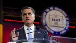 Republican presidential candidate, former Massachusetts Gov. Mitt Romney gestures during a speech to the NAACP annual convention in Houston, Texas, July 11, 2012.