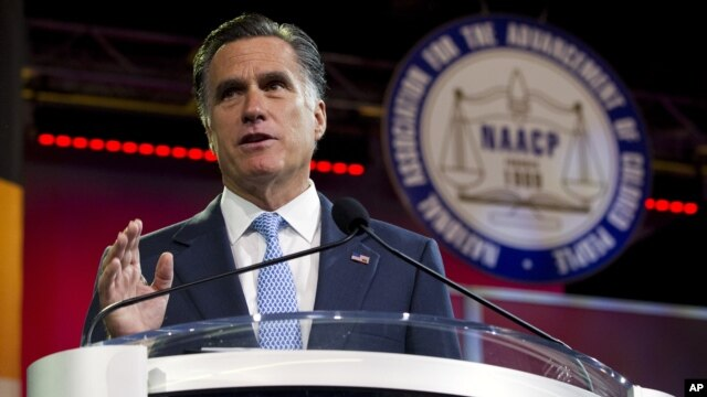 Republican presidential candidate Mitt Romney gestures during a speech to the NAACP annual convention in Houston, Texas, July 11, 2012.