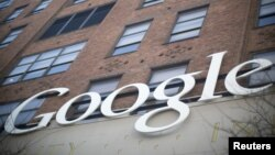 The Google signage is seen at the company's headquarters in New York January 8, 2013. Google Inc and a New York redevelopment organisation are providing a Manhattan neighbourhood with free public WiFi Internet access, making it the largest area of coverag