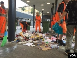 Workers cleaning up Budapest's Keleti station after Hungary started bussing migrants to the Austrian border. (Luis Ramirez/VOA)