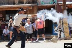 Actors perform a fake Wild West style shootout.