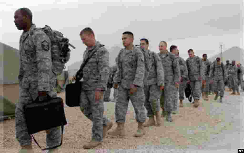 U.S. servicemen queue to board a bus as they begin their journey home at al-Asad Air Base west of Baghdad, Iraq, Tuesday, Nov. 1 , 2011. The U.S. has promised to withdraw from Iraq by the end of the year as required by a 2008 security agreement between Wa