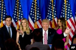 FILE - Then-Republican presidential candidate Donald Trump is joined by his wife, Melania; his daughter, Ivanka; and his son-in-law, Jared Kushner, as he speaks during a news conference at the Trump National Golf Club Westchester, June 7, 2016, in New York.