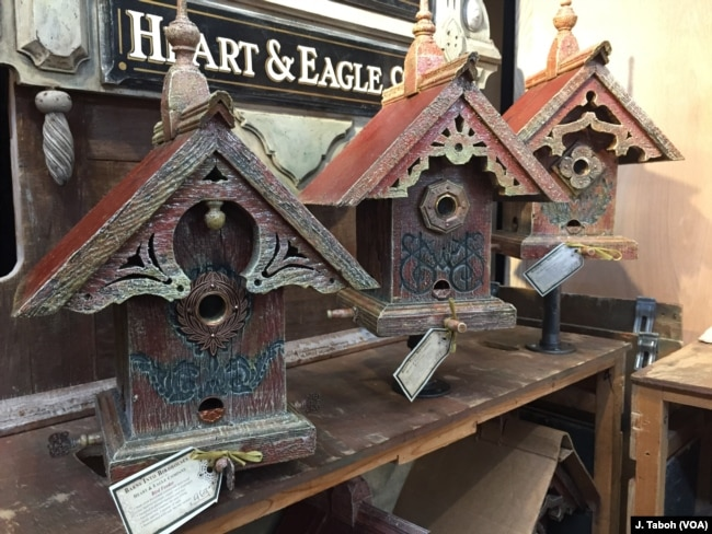 Artisan John Guertin combines his love of architecture and the environment by creating one-of-a-kind birdhouses and feeders using wood from century-old barns from his home state of Michigan.