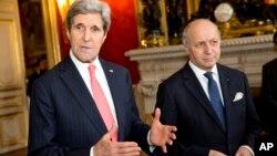 2014年2月19日国务卿约翰·克里与法国外长法比尤斯 (资料照片)