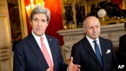 Ngoại trưởng Mỹ John Kerry trong cuộc họp báo chung với Ngoại trưởng Pháp Laurent Fabius tại Paris, ngày 19/2/2014.