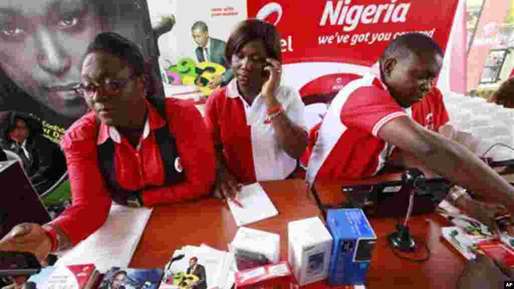 Staffs of Airtel attend to a customer during the launch of mobile number portability in Lagos, Nigeria, Monday, April 22, 2013.