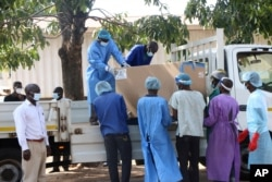 COVID-19 vaccines arrive to be destroyed, in Lilongwe, Malawi, May 19, 2021. Malawi has burned nearly 20,000 doses of AstraZeneca vaccines because they had expired.