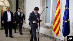 Catalonia regional President Carles Puigdemont arrives for a statement after signing the decree officially calling for the vote on a binding independence referendum, following a plenary session at the Parliament of Catalonia in Barcelona, Spain, Sept. 6,