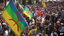 Demonstrators carry the Berber flag in solidarity with protests in the neglected northern Rif region, during a protest in Casablanca, Morocco, Oct. 8, 2017.