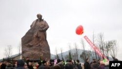 FILE - A statue of former Communist Party chief Hu Yaobang, a reformer whose death sparked the Tiananmen Square democracy protests, being unveiled in Taizhou, east China's Zhejiang province, Jan. 13, 2013.