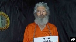 This undated handout photo provided by the family of Robert Levinson, shows retired-FBI agent Robert Levinson being held.